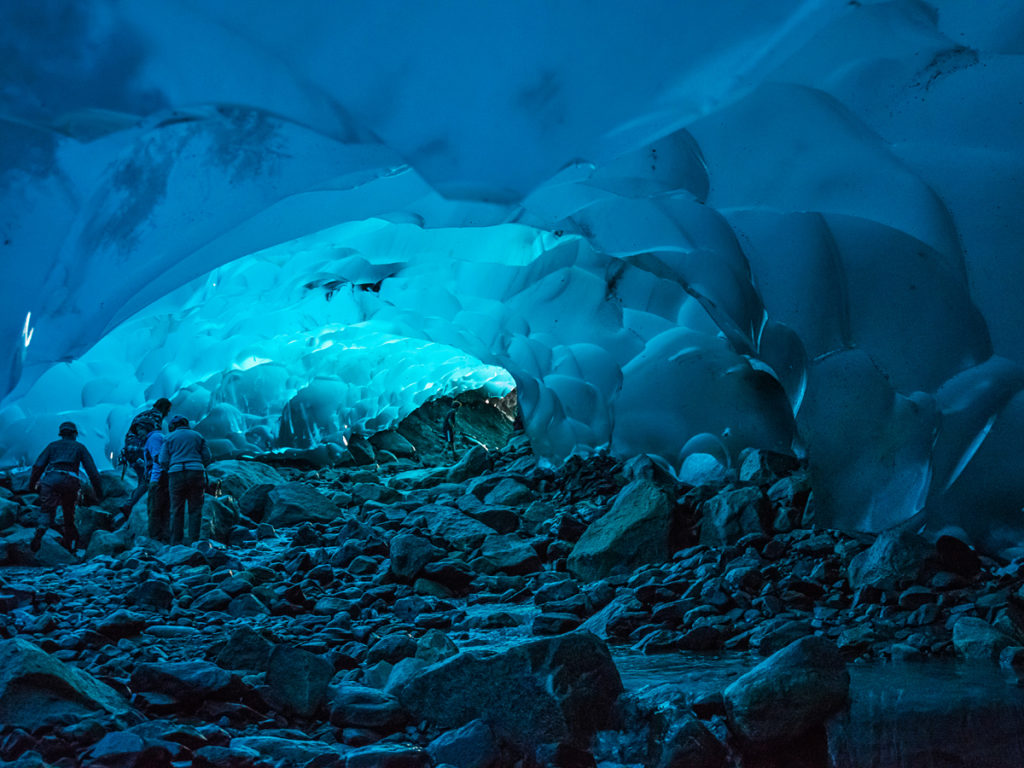 This is Lauren in an ice cave under the Mendenhall Glacier near Juneau, Alaska