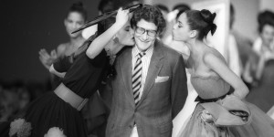 French designer Yves Saint Laurent is kissed by models at the end of his fashion show in Paris