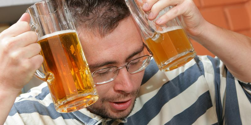 Man to have a hang-over in a pub